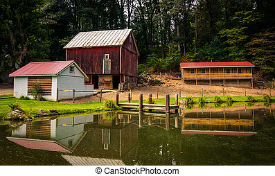 Reflection of barn and house in a small pond in rural York County, Pennsylvania.