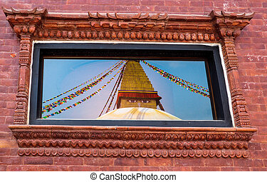 Reflection of Boudhanath Stupa in a glass window