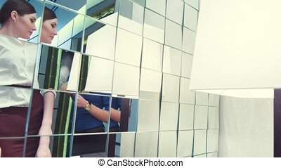 Reflection of businesswomen in the mirror - Second...
