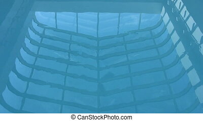 Reflection of Ceiling Fan On Pool