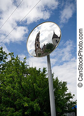Reflection of church in a road mirror