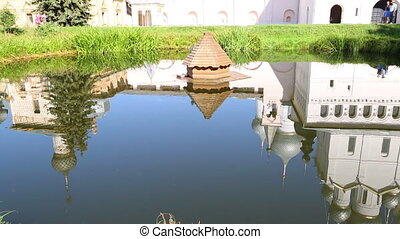 Reflection of Church of the Resurrection in Rostov Kremlin. Rostov The Great is a tourist center of the Golden Ring of Russia. Tilt view