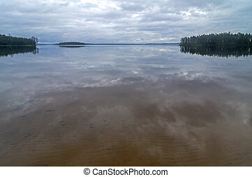 Reflection of clouds in the clear lake.