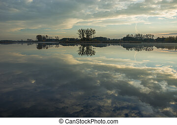 Reflection of clouds in the water of a calm lake
