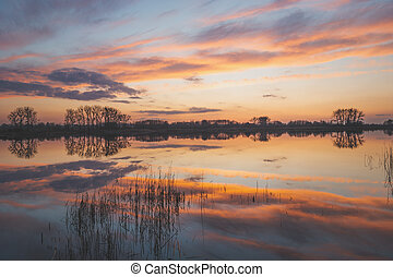 Reflection of colourful clouds in the lake