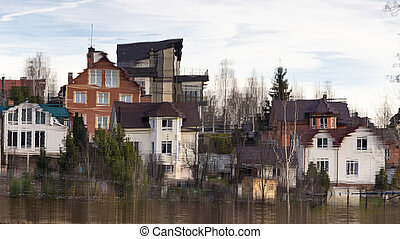 Reflection of cottages in the water