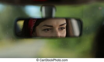 Reflection of cute woman in car rearview mirror - Adorable...