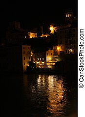reflection of lights on the Brenta river in the city of Bassano at night