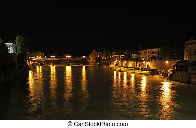 lights on the Brenta river in the city of Bassano