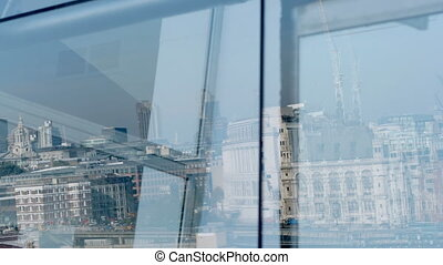 reflection of London skyline in oxo tower window