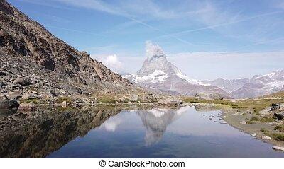 Matterhorn on Riffelsee Lake - Reflection of Mount ...