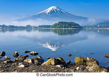 Reflection of Mt. Fuji with rock shore foreground, Kawaguchiko lake, Yamanashi