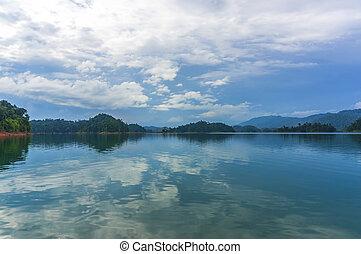 Reflection of rain forest at Kenyir lake, Malaysia
