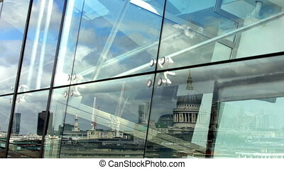 reflection of st pauls cathedral in glass window