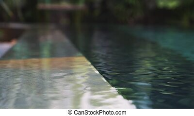 Reflection of sunlight in blue swimming pool water.