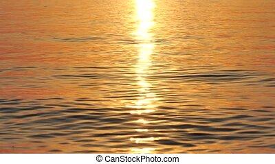 Reflection of sunrise on the sea waves Turkey
