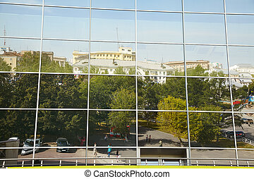 reflection of the city in a modern building