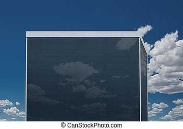 Reflection of the clouds in the high-rise building