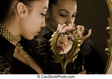 Reflection of the girl in mirrors with an antiquarian frame...
