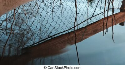 reflection of the lattice in water and the drop falls at the...