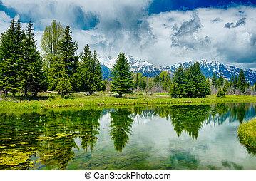 Reflection of the mountain peaks at Schwabacher landing, Grand Teton national park. Wyoming, USA