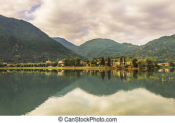 reflection of the sky and the mountains in the lake water