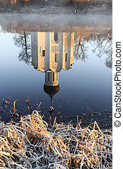 Reflection of the traditional Russian church in the Gulf of the Nerl River in the early autumn morning