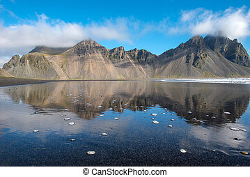 Reflection of Vestrahorn mountain in Stokksnes, Iceland