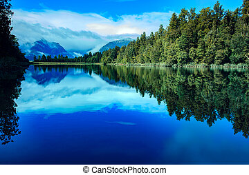 reflection scenic of lake matheson in south island new...