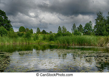 Reflections in a lake with sky and trees