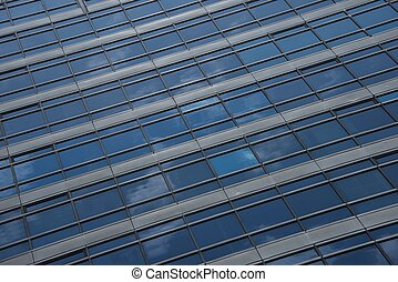 Reflections of clouds in blue glass