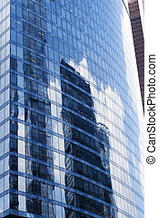 Reflections of clouds in windows of a skyscraper