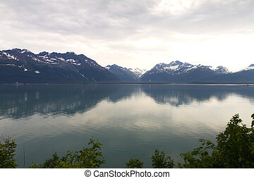 reflections of mountains in valdez bay