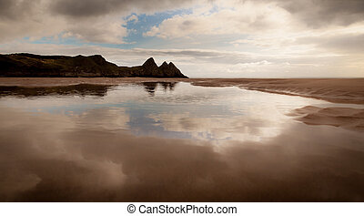 Reflections of Three Cliffs Bay