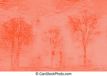 Reflections of trees in icy water. Orange pastel toned