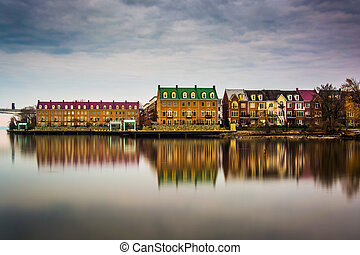 Reflections of waterfront buildings along the Potomac River ...