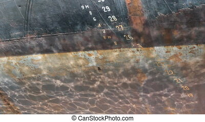 Reflections on rusty hull. - Sunny reflections on rusty...