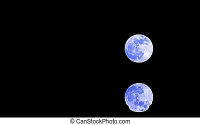 reflections on the ocean of a shining full BLEU moon in the dark