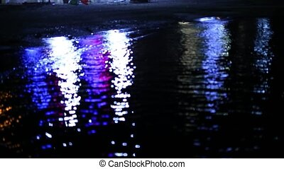 Reflections on the water at night. The path of light reflections