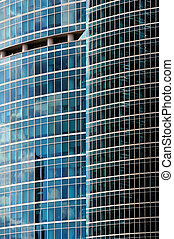 Reflections in a glass skyscraper wall, abstract background