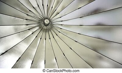 Reflective umbrella inside is shown in motion from left to...