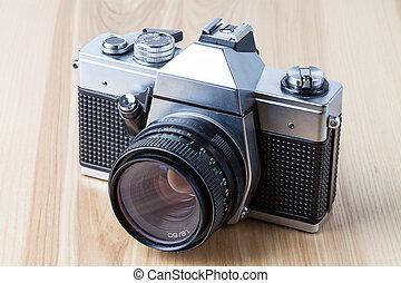 Reflex camera, closeup - A silver and black old-fashioned ...