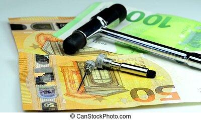 reflex hammer with euro bills