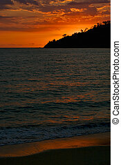 sunset in the isle of nosy be madagascar the ocean and the hill