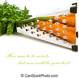 reflexion - carrots reflected in the grater over white...