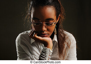 Reflexive teen girl - Portrait of teenage african woman with...