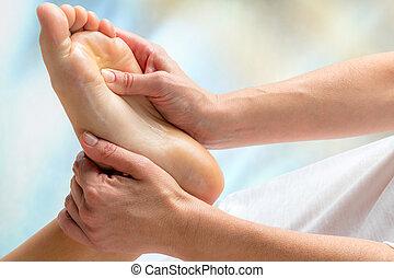 Reflexologist doing treatment on foot. - Macro close up of...