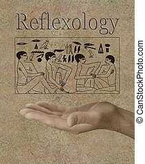 Male hand facing up with Egyptian hieroglyphic panel of foot massage scene floating above and the word Reflexology on stone background