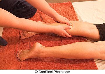 reflexology leg massage, Thai traditional massage, Thailand.