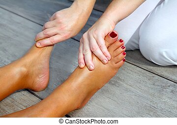 Reflexology woman feet massage therapy